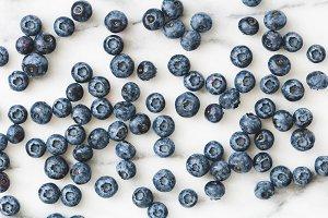 Fresh blueberry over white marble