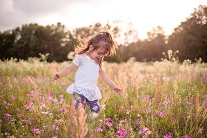 Little girl in a purple flower field