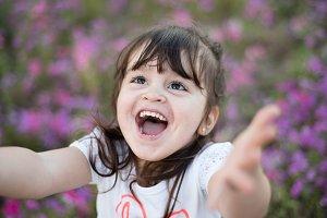 Little girl in a purple flower field