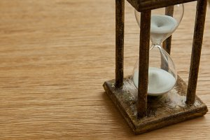 Hourglass on the Oak table as time p
