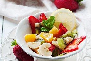 fruit salad with banana, kiwi, straw