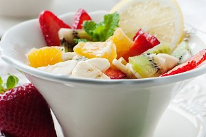 fruit salad with banana, kiwi, straw