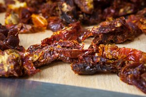 Sun Dried Tomatoes on a Wooden Board