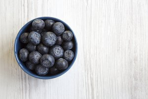 Blueberries in a blue bowl, top view
