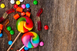 Colorful candies on wood