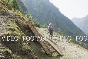 Backpacker on the nepalese path