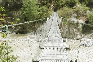 Suspension bridge over the river in