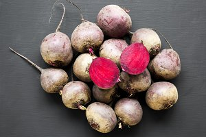 Red beetroot on black background