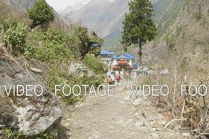 Backpackers in nepalese trekking