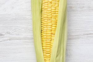 Ear of corn on a white wooden