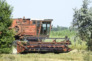 Old rusty combine harvester.