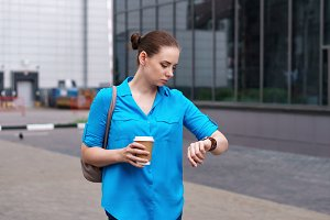 Girl with coffee and wristwatch