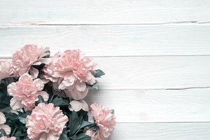 rag flowers. Wooden background