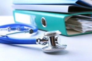 books folder file, stethoscope, red