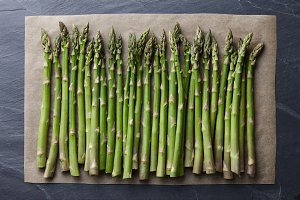 Green asparagus on a baking paper