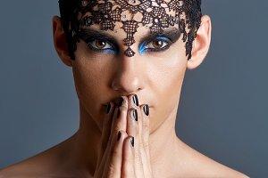 young man wiht dark makeup