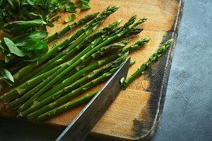cutting board with asparagus