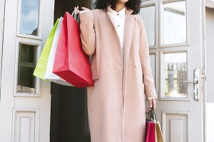Pretty girl standing with shopping