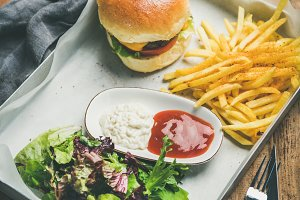 Beef burger, french fries, salad and