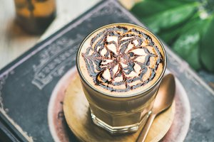 Latte coffee with chocolate sauce