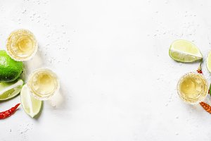 Gold mexican tequila with lime and s