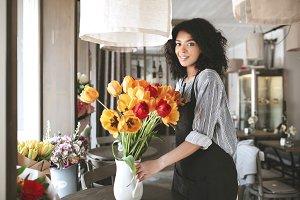 Beautiful florist in apron creating