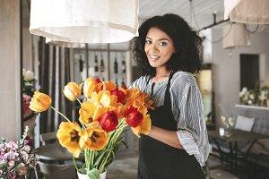 Beautiful florist in apron working