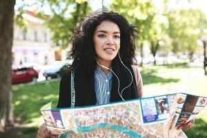 Young girl in earphones thoughtfully