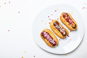 Eclairs cakes with chocolate icing a