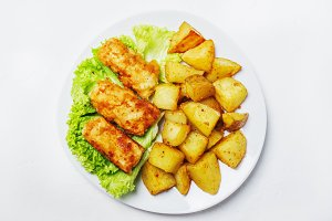 Fish and chips on a plate, white bac
