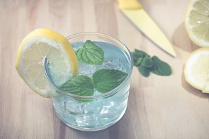 Blue tonic gin with mint leaves and