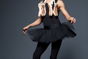 handsome ballet artist in tutu skirt