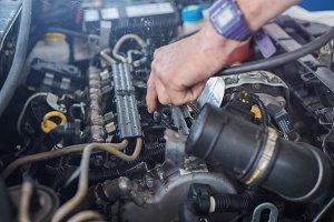 Auto mechanic repairing car.