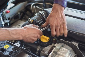 Auto mechanic hands with wrench