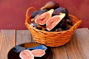Ripe figs at orange basket