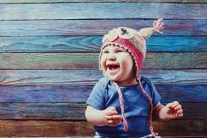 Smiling baby wearing funny hat