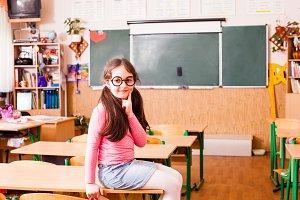 Happy smart girl in classroom