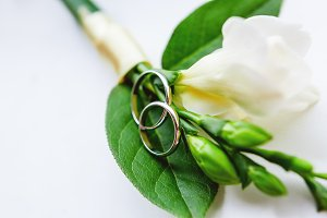 Boutonniere and wedding rings