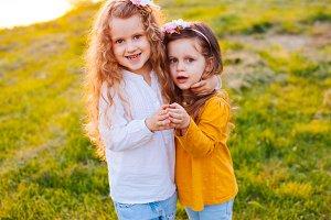 Two girls making heart