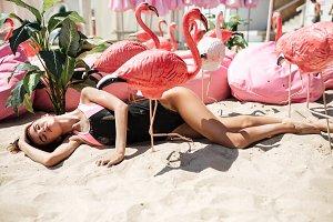 Cute girl in trendy swimsuit lying