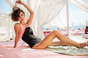 Beautiful girl in trendy swimsuit