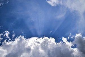 Sun rays breaking through cumulus