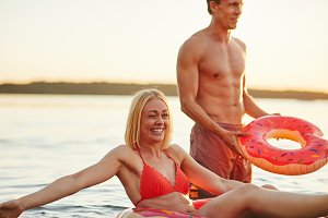 Smiling couple in bathing suits have