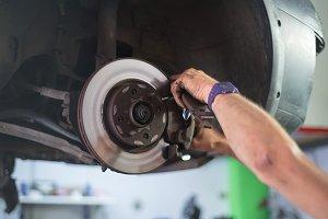 Close up of car mechanic repairing b