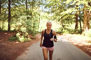 Fit young woman listening to music d
