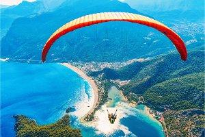 Paraglider tandem flying over sea