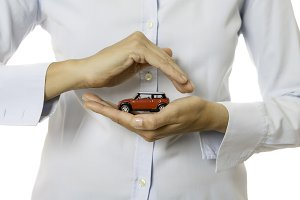 hands holding a toy car