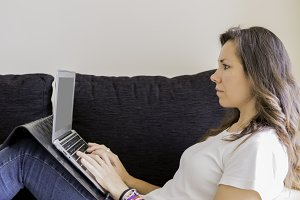 woman with a laptop on a sofa