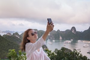 woman doing selfie on the top ofhill