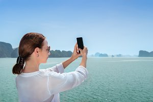 Woman on boat and making selfie
